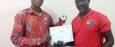 Beach Volleyball Coach Mumuni Presents Medal And Certificate To President Of Ghana Volleyball Association