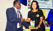 Madam Bernice receiving award