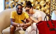 Photos of Singer, D'Banj 'Romancing' Wife in Public
