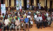 A cross-section of farmers waiting to be screened