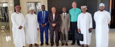 Dr. Owusu Kizito, Chairman/CEO of Investigroup ( third from left ) with Dr. P Mohamed Ali ( fourth from left -A multibillionaire industrialist and Chairman of MFAR Group of Companies ), Dr. Peter Ikre, CFO of Investigroup, Christian Piendl- German Consultant, Humaid Al Habsy- Investigroup's local representative, Mohiudin Mohammed Ali, V P of GALFAR. First and second from left include Ahmed Al Habsy and Dr. Salim