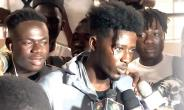 Kwesi Slay being interviewed by the media