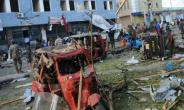 The aftermath of a bombing in Somalia which killed at least 14 people outside a Mogadishu hotel in March, 2018, and for which Shabaab militants claimed responsibility.  By Mohamed ABDIWAHAB (AFP/File)