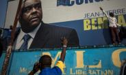 The former vice president of DR Congo Jean-Pierre Bemba (here pictured on a poster at the Congolese Liberation Movement headquarters,) was acquitted last month of war crimes and was on Friday named by his party as a candidate in presidential polls planned for December.  By JOHN WESSELS (AFP)