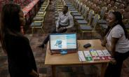 The head of the DR Congo's election commission says millions of duplicate names have been found on voter lists.  By John WESSELS (AFP)