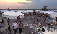 The IDP camp at Bentiu in northern South Sudan is a collection of mud-and-tarp houses arranged in blocks and bracketed by trenches of slimy green sewage that serve as playgrounds for children.  By - (UNMISS/AFP/File)