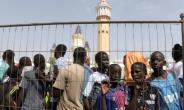 The mother of all queues: Trying to get into Touba's mosque during the big weekend.  By SEYLLOU (AFP)