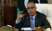 Then-prime minister Ali Zeidan holds a press conference in the Libyan capital Tripoli on July 24, 2013.  By MAHMUD TURKIA (AFP/File)