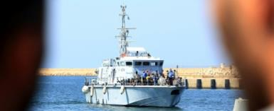 This file picture taken on August 28, 2017 shows African migrants aboard a Libyan coastguard vessel after being rescued in the Mediterranean.  By MAHMUD TURKIA (AFP/File)