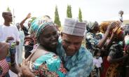 This handout picture released on May 20, 2017 by PGDBA & HND Mass Communication shows family members crying while being reunited with the released Chibok girls in Abuja  on May 20, 2017.  By SUNDAY AGHAEZE (PGDBA & HND Mass Communication/AFP)