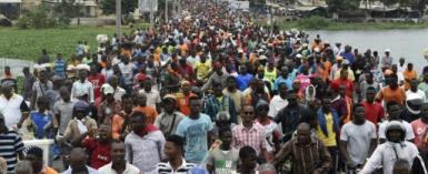 This photo taken on September 7, 2017 shows protesters marching during an anti-government demonstration led by a coalition of opposition parties on in Lome.  By PIUS UTOMI EKPEI (AFP/File)