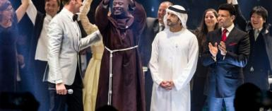 This picture provided on March 24, 2019 by the Global Education and Skills Forum of the Varkey Foundation, shows Kenyan teacher Peter Tabichi (C) in Dubai holding up the trophy for world's best teacher which comes with a prize of $1 million.  By - (Global Education and Skills Forum/AFP)