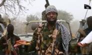 This screen grab image taken on December 29, 2016 from a video released on Youtube by Islamist group Boko Haram shows Boko Haram leader Abubakar Shekau making a statement at an undisclosed location.  By HO (BOKO HARAM/AFP/File)