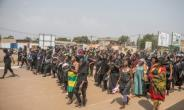 Togolese women dressed in black, some banging on pots, are pictured protesting in the capital city of Lome during a protest rally against Togo's president on January 20, 2018.  By Yanick Folly (AFP/File)