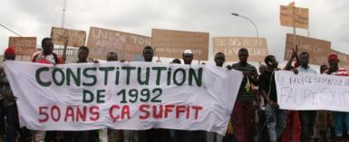 Togolese opposition supporters display a banner reading