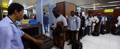 Travellers pass through security at Tripoli's Mitiga airport in July 2014 after clashes between rival militias closed the main international airport.  By MAHMUD TURKIA (AFP/File)