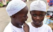 Twin brothers Salim and Mahamadou Cisse, just five years old, beg at the busy market of Abobo, a suburb of Ivory Coast's commercial capital Abidjan.  By ISSOUF SANOGO (AFP)