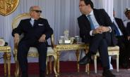 Tunisian President Beji Caid Essebsi (L) and Prime Minister Youssef Chahed attend a Tunisian naval drill on June 25, 2018.  By FETHI BELAID (AFP)