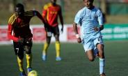 Uganda's Emmanuel Okwi (L) runs with the ball next to Eritrea's Selemon Yonatan during a Council for East and Central Africa Football Associations (CECAFA) Cup football match in Nairobi, on December 2, 2013 in Nairobi.  By SIMON MAINA (AFP/File)