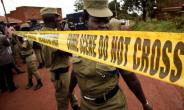 Uganda's police officers cordon off the scene where senior police officer Andrew Felix Kaweesi was murdered in a Kampala Suburb on March 17, 2017.  By ISAAC KASAMANI (AFP/File)