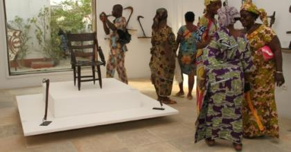Visitors contemplate artefacts recently returned to Benin and on show at Cotonou's