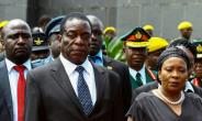 With President Mugabe, 93, in increasingly frail health, speculation has focused on Mnangagwa (pictured with wife Auxilia) to succeed him.  By Jekesai NJIKIZANA (AFP/File)