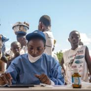 World Health Organization nurses prepare to administer vaccines at the city of Mbandaka on May 21, 2018 during the launch of an Ebola vaccination campaign as the death toll in DR Congo continues to rise.  By JUNIOR KANNAH (AFP)