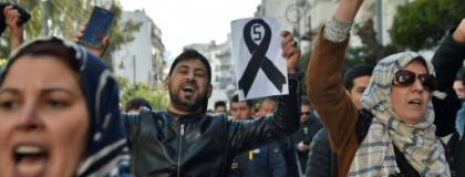 Young demonstrators take part in a protest against President Abdelaziz Bouteflika's candidacy for a fifth term in Algiers.  By RYAD KRAMDI (AFP)