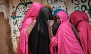 Young Somali refugee women stand together at Dadaab, one of the biggest refugee bases in the world.  By Yasuyoshi CHIBA (AFP/File)