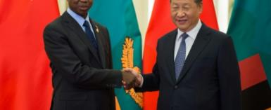 Zambian President Edgar Lungu with his Chinese counterpart Xi Jinping in Beijing. Zambia has been handing lucrative contracts to Chinese firms.  By Nicolas ASFOURI (POOL/AFP/File)