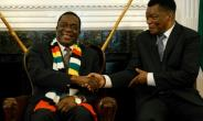 Zimbabwe President Emmerson Mnangagwa, seen here shaking hands with the newly-appointed prosecutor general Kumbirai Hodzi, has pledged to investigate any misconduct by the security forces.  By Jekesai NJIKIZANA (AFP)