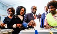 Zimbabwean president Robert Mugabe bowed to pressure and resigned in November 2017. Here he casts his first post-ouster vote, in July 2018.  By Zinyange AUNTONY (AFP/File)