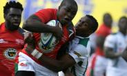 Zimbabwe's Lenience Tambwera (R) tackles Kenya's Isaac Adimo during the 2018 Rugby African Gold Cup match in Nairobi on June 30, 2018, which acts a qualifier for the 2019 Rugby World Cup in Japan.  By SIMON MAINA (AFP)