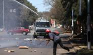 Zimbabwe's President Robert Mugabe accused foreign powers of having a hand in the unrest which saw opposition supporters clash with police in Harare.  By Wilfred Kajese (AFP)