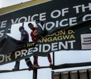 Zimbabwe's presidential election has left deep scars. In this August 1 picture, supporters of the opposition MDC rip an electoral poster for the ruling ZANU-PF.  By Luis TATO (AFP)