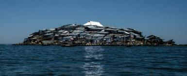 A newly-built tin roof shines on top of Migingo island where its residents fish mainly for Nile perch in Lake Victoria on the border of Uganda and Kenya.  By Yasuyoshi CHIBA (AFP)