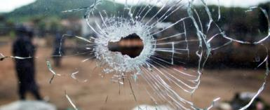 A bullet hole in a window after fighting, in Kasese, Uganda in December 2016.  By Badru KATUMBA (AFP/File)