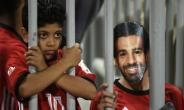 A fan wearing a mask of Egyptian football star Mohamed Salah poses for a photograph  prior to the 2019 Africa Cup of Nations qualifier between Egypt and Niger on September 8, 2018 at the Borg el-Arab stadium near the Mediterranean city of Alexandria.  By KHALED DESOUKI (AFP/File)
