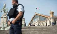 A French police officer stands outside Saint-Charles train station in Marseille on October 1, 2017, after Ahmed Hanachi killed two people.  By BERTRAND LANGLOIS (AFP/File)