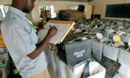 A Kenyan election official counts ballot boxes at a polling station in Wamba.  By Cyril Villemain (AFP)