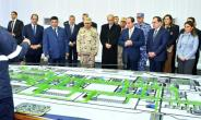 A picture released by the Egyptian Presidency on January 31, 2018 shows President Abdel Fattah al-Sisi (3rd-R) looking at mockups of natural gas extraction facilities during the inauguruation of the offshore Zohr gas field.  By Handout (EGYPTIAN PRESIDENCY/AFP)