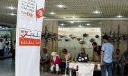 A picture taken on August 4, 2017 shows employees of the Tunisian ISIE elections body sitting at an outreach booth at a shopping mall in the capital Tunis, in a bid to encourage citizens to register to vote in the upcoming municipal elections.  By FETHI BELAID (AFP/File)