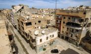 A picture taken on March 13, 2018 shows a general view of destroyed buildings in a central district in the eastern Libyan city of Benghazi..  By Abdullah DOMA (AFP)