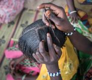 A woman braids a girl's hair at a camp for the internally displaced in northeast Nigeria, where rights groups say women and girls are at serious risk of sexual abuse and rape.  By STEFAN HEUNIS (AFP/File)