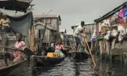Around a quarter of a million people live in Makoko -- it is believed to be the biggest floating community in the world.  By STEFAN HEUNIS (AFP)