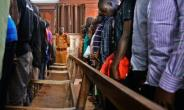 At the first hearing in the capital Kampala dozens of male suspects in sexual violence cases filed into court, chained two-by-two, to appear before Lady Justice Jane Frances Abodo.  By Isaac Kasamani (AFP/File)