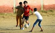 Boys play football at the Mohamed Salah Youth Center in the Egyptian village of Nagrig, the home village of Liverpool's top scorer and Africa's top player Mohamed Salah.  By MOHAMED EL-SHAHED (AFP)