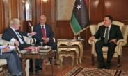 British Foreign Minister Boris Johnson (L) meets in Tripoli with Fayez al-Sarraj (R), head of Libya's UN-backed Government of National Accord.  By STR (AFP)