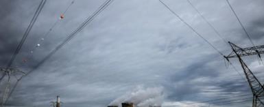 Cash-strapped power monopoly Eskom had been plagued by maintenance problems at its plants, the towers of one of which are seen in Hendrina, South Africa in 2018.  By MARCO LONGARI (AFP/File)