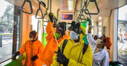 Cleaning staff disinfect a metro carriage in Addis Ababa -- Ethiopia announced its first COVID-19 deaths Sunday.  By Michael Tewelde (AFP)